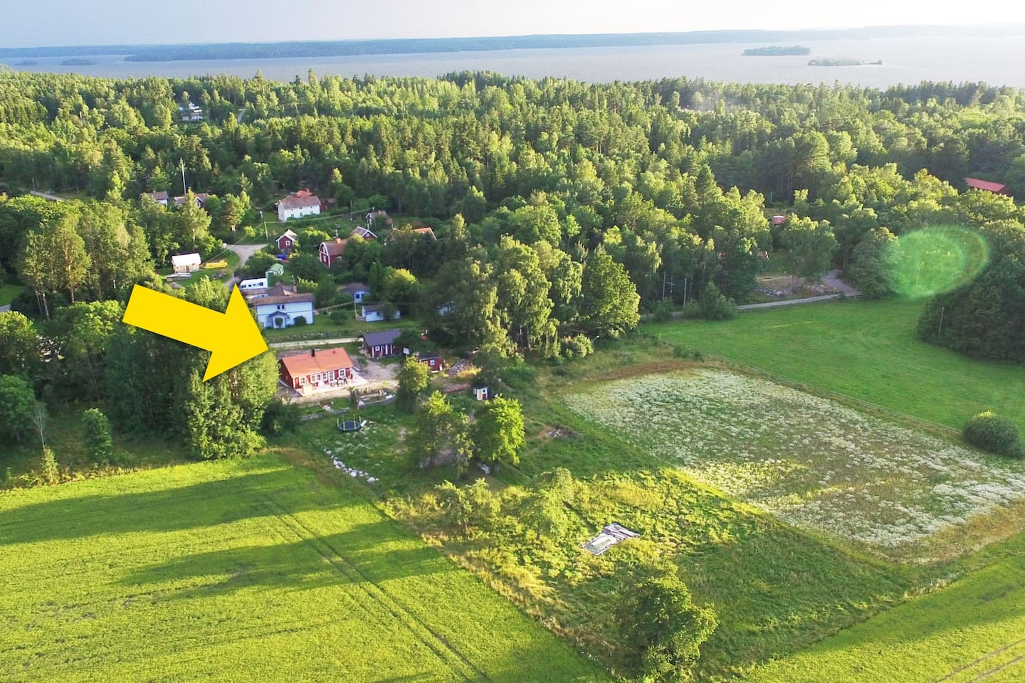 The house and the village of Hallsta. The lake Mälaren in the background.