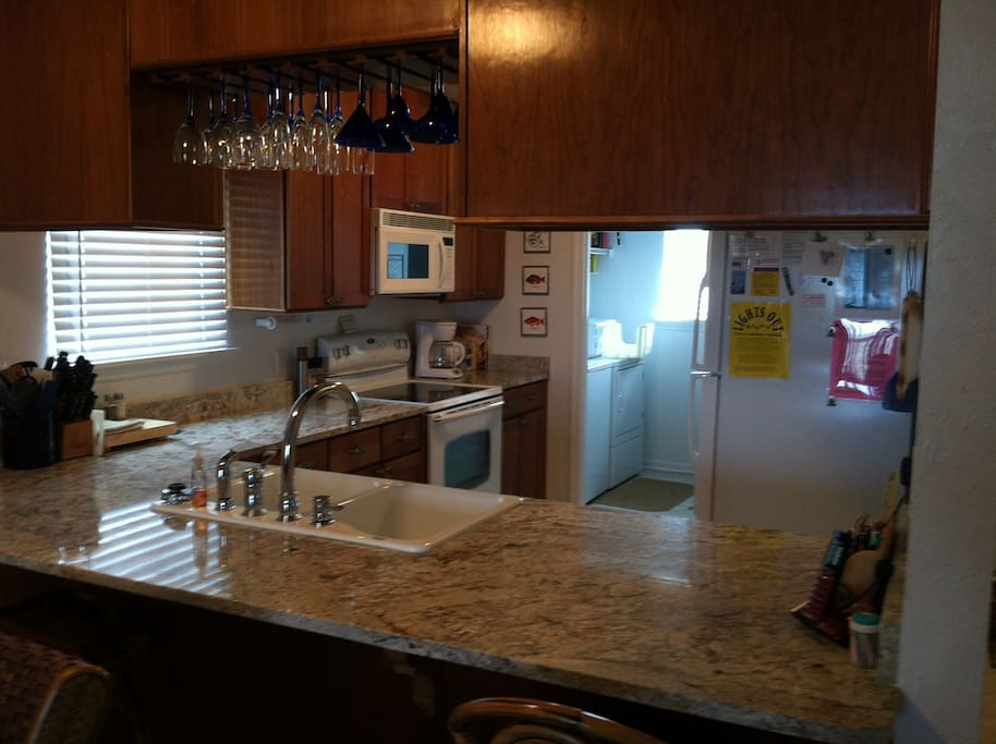 Modern kitchen with plenty of appliances.