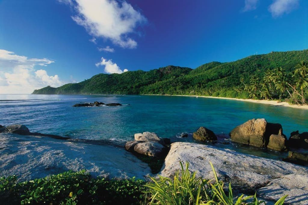 The gorgeous bay of Anse Forbans just steps from your private chalet.