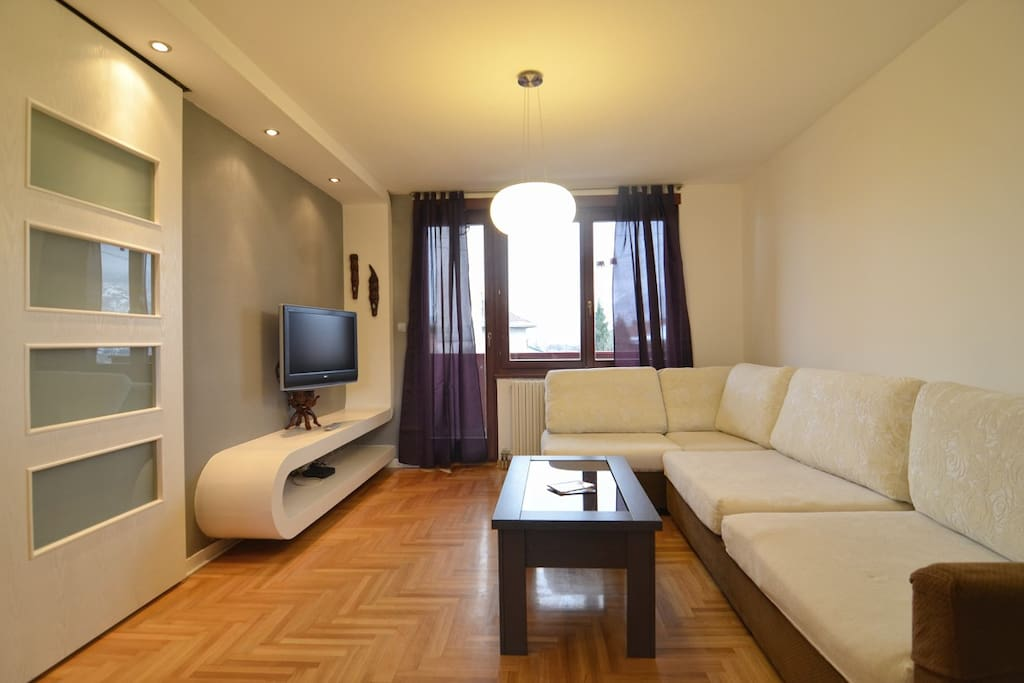 Large and bright living room with exit to the balcony with beautiful view over Sarajevo.