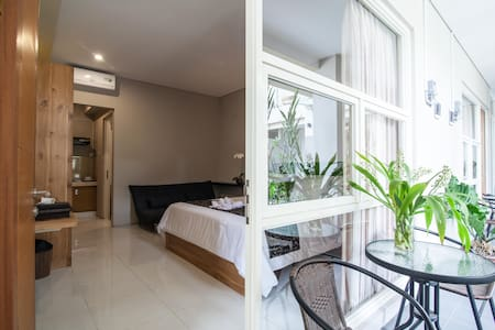This apartment is located in the first floor of Bali True Living Apartment. the bedroom has very large space (28 meter²), in-room private kitchen & bathroom, and sharing balcony with a tropical garden view.