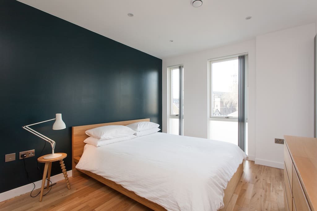 Floor to ceiling windows with black out blinds for sleeping.