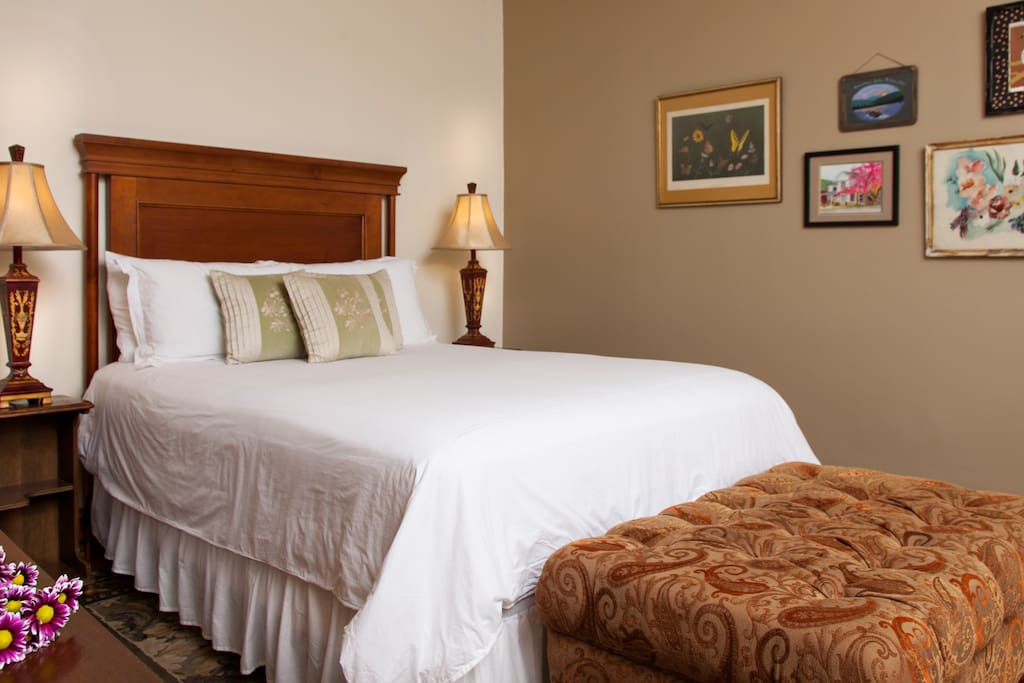 The Nadine Suite with a queen size bed.