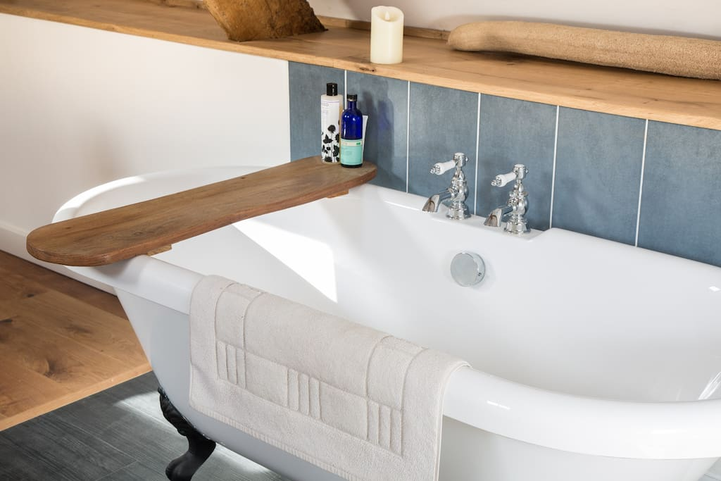The rolltop bath...with a handmade bath caddy and alarmingly realistic electric wax candles