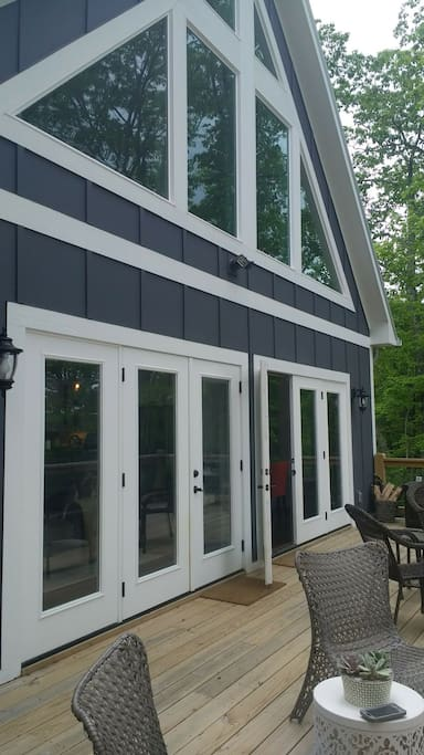 The wrap around deck access leads to and from the living room and kitchen area.