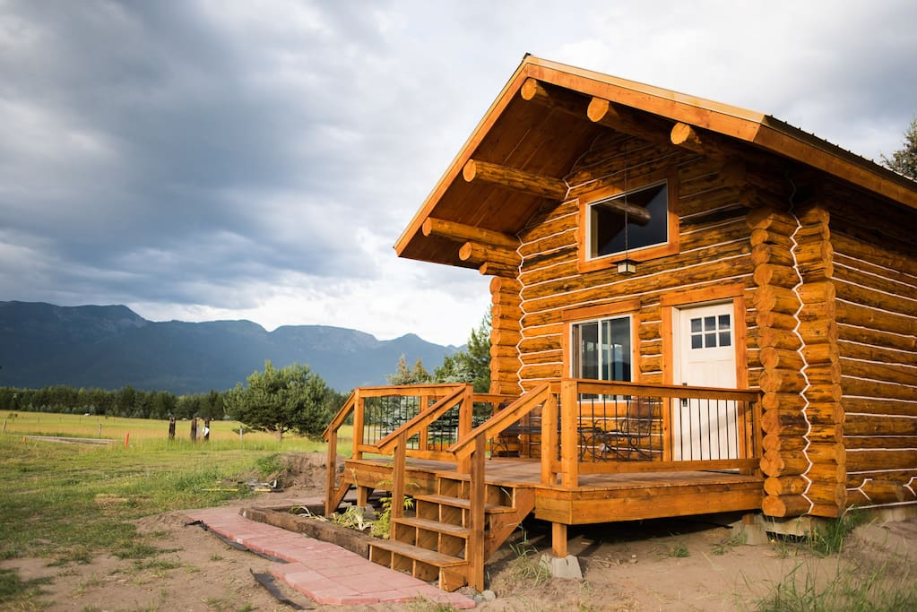 """Front of cabin with pastures, 6 horses, and forest between cabin and Mountains. You WILL see deer and maybe even see foxes. You probably won't SEE a bear, but you may see """"bear scat"""".  TAKE A JOG AROUND THE 40 acres, going through woods and horse pasture."""
