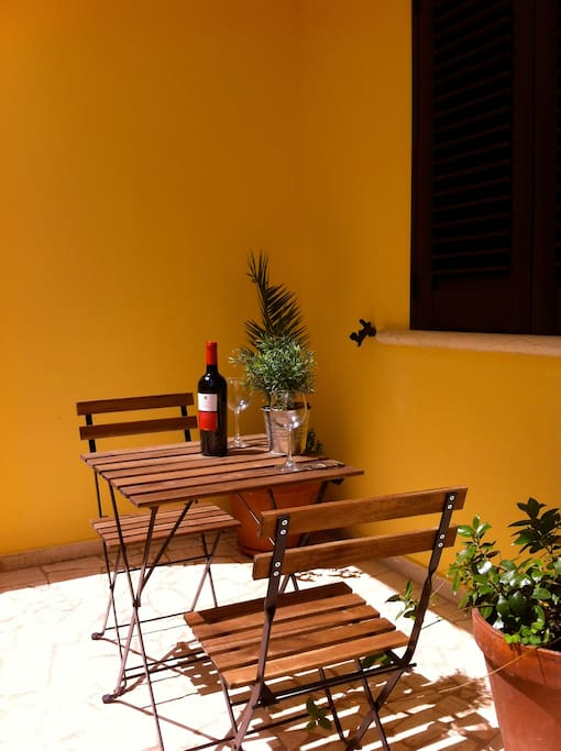 Enjoy a glass of Puglian red at the apartment entrance