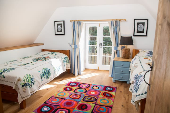 The double (with a third pull-out bed if required) bedroom, with Juliette balcony