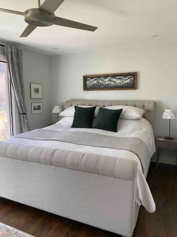 Main bedroom with king size bed and views over the Bow river