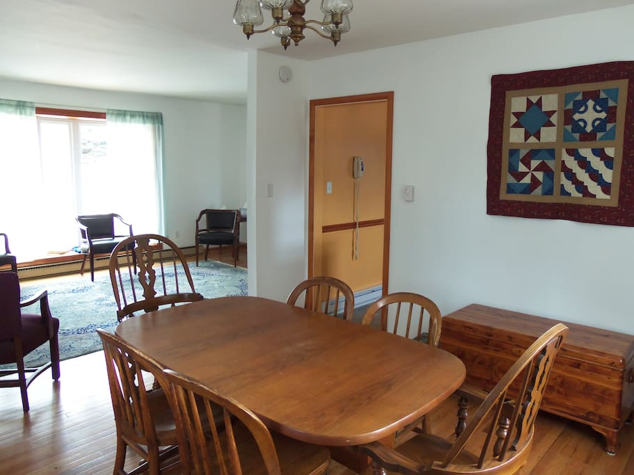 Dining area with sturdy antique oak chairs.
