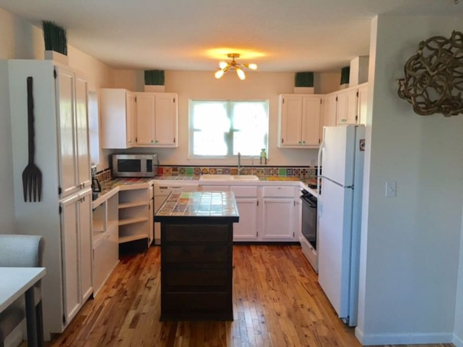 Full kitchen: dishwasher, gas stove, oven, fridge, coffee station, microwave