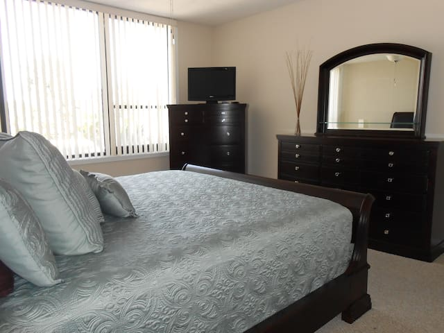 Master Bedroom with King sized bed TV/DVD