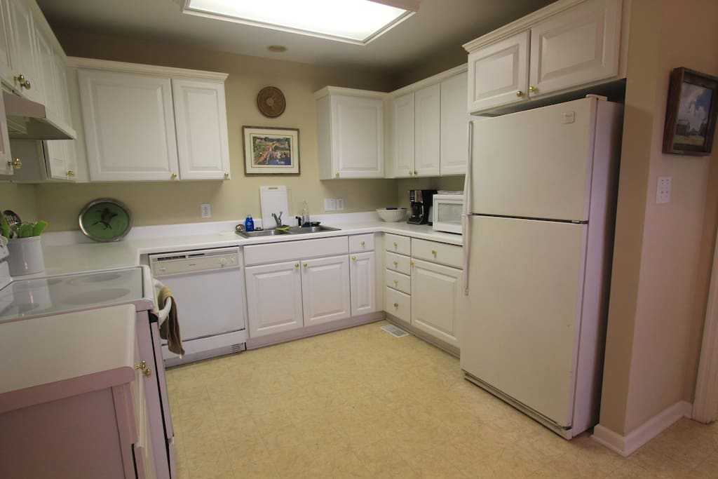 Fully furnished kitchen with dishwasher, disposal, microwave, cookware, dishes, utensils, etc.