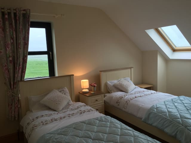 The twin room with stunning views from all 3 windows
