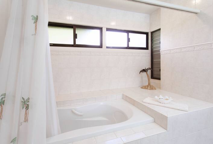 The master bath is high end remodel with large soaking tub, 2 separate vanities, custom lighting and private toilet