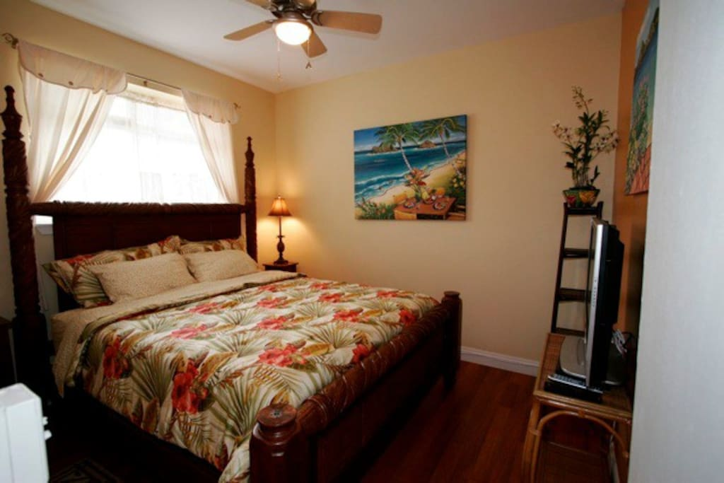 Welcome to your private, artist-designed bedroom with a King bed, flat screen TV and high end wall-mounted A/C.