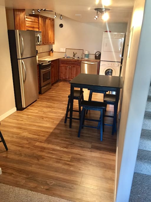 Kitchen with full appliances and washer/dryer.