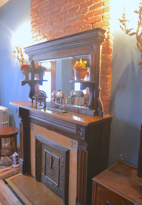 Mahogany mantel and original tiled fireplace built in 1880.
