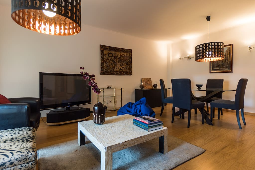 Beautifully decorated living room, with cable TV