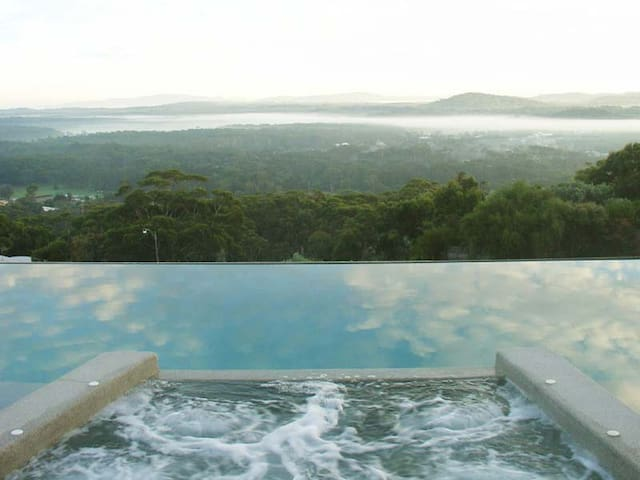 Shared Infinity Edge pool and spa looks out over the national park and bay.