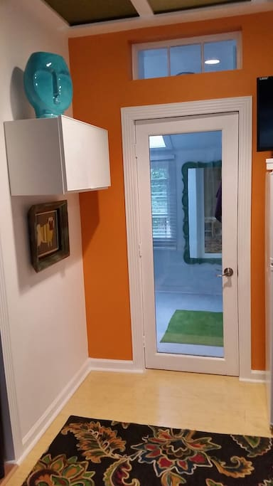 Entry to bathroom, with sound insulating glass door.