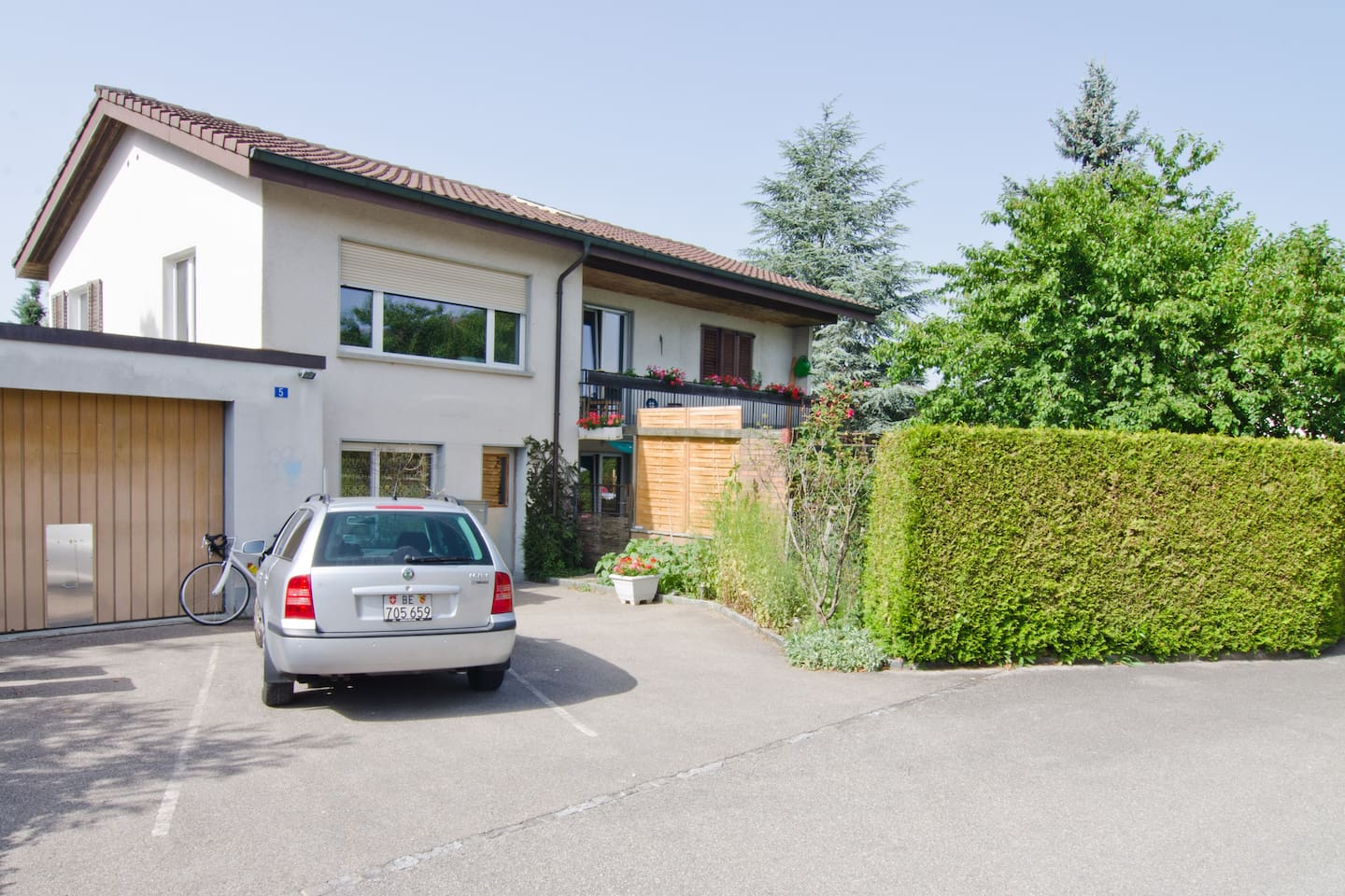 front view of our house with the entrance door and big parking space (3 cars)