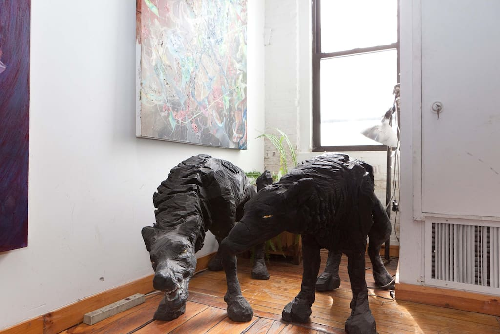 Our guardian dogs, sculpted by a former artist resident.