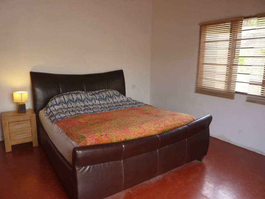 The bedroom is simple but large and spacious with a King size bed.