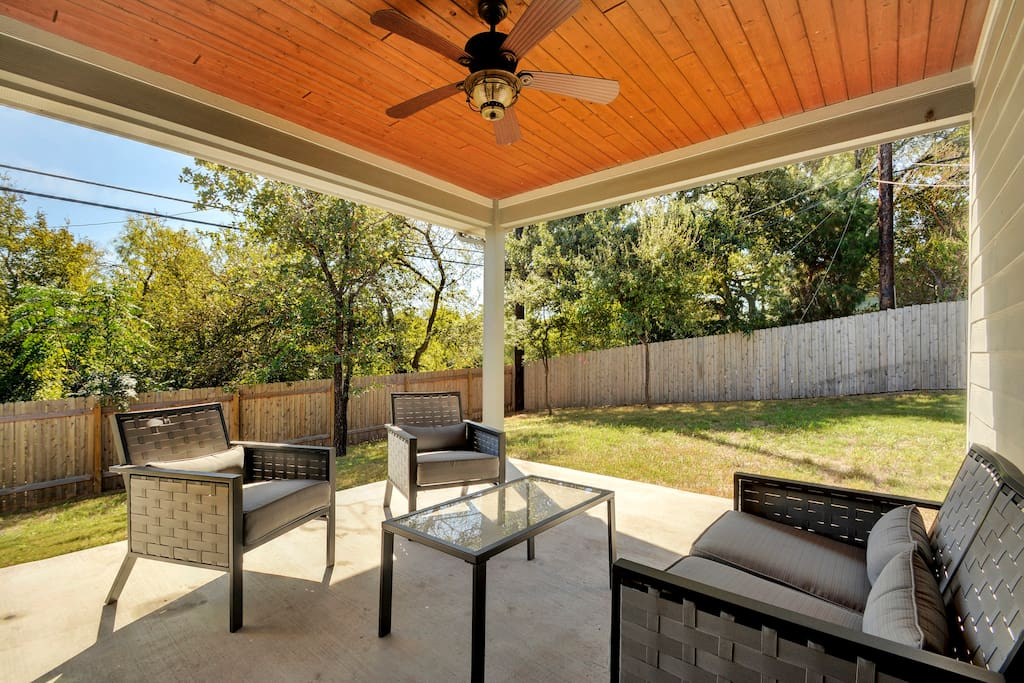 Sunny back yard with trees and private fencing. Enjoy the stainless steel gas grill.