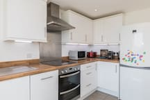 Dishwasher, fridge/freezer, microwave, coffee machine, kettle. Help yourself to anything in our kitchen while you visit