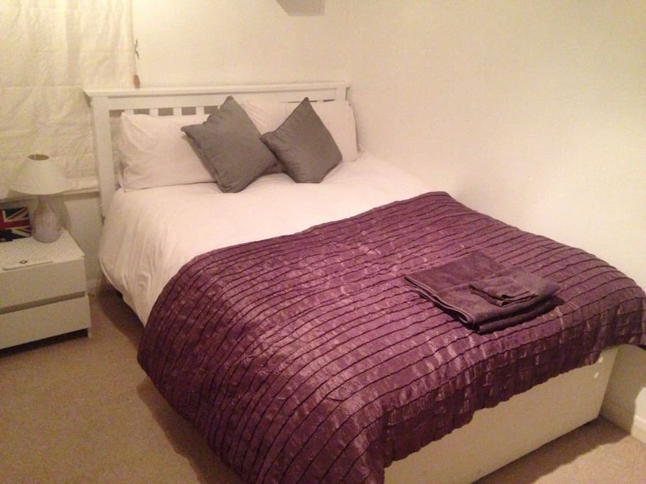 This is my guest room - a comfortable double bed. My visitors love it