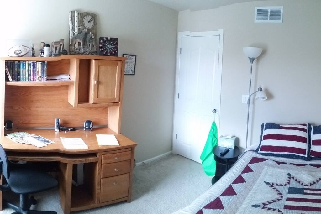 Desk to work, with magazines and restaurant coupons, laundry bag, nightstand