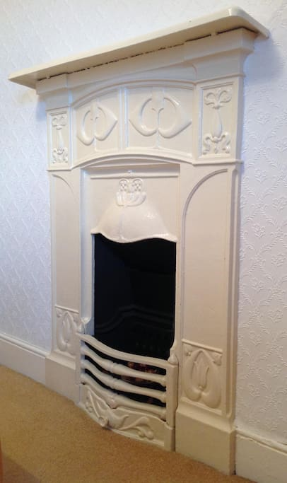 Original cast iron fireplace - sadly for decoration only now.