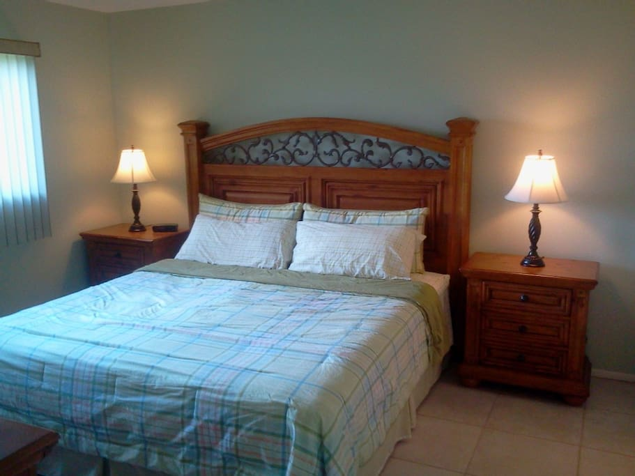 """Master Bedroom with King-size bed and 37"""" flat screen TV."""