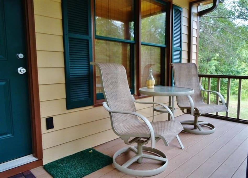 Relax out on the screened front porch and admire the surrounding scenery.