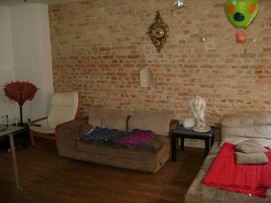 Living room with Red Bricks wall
