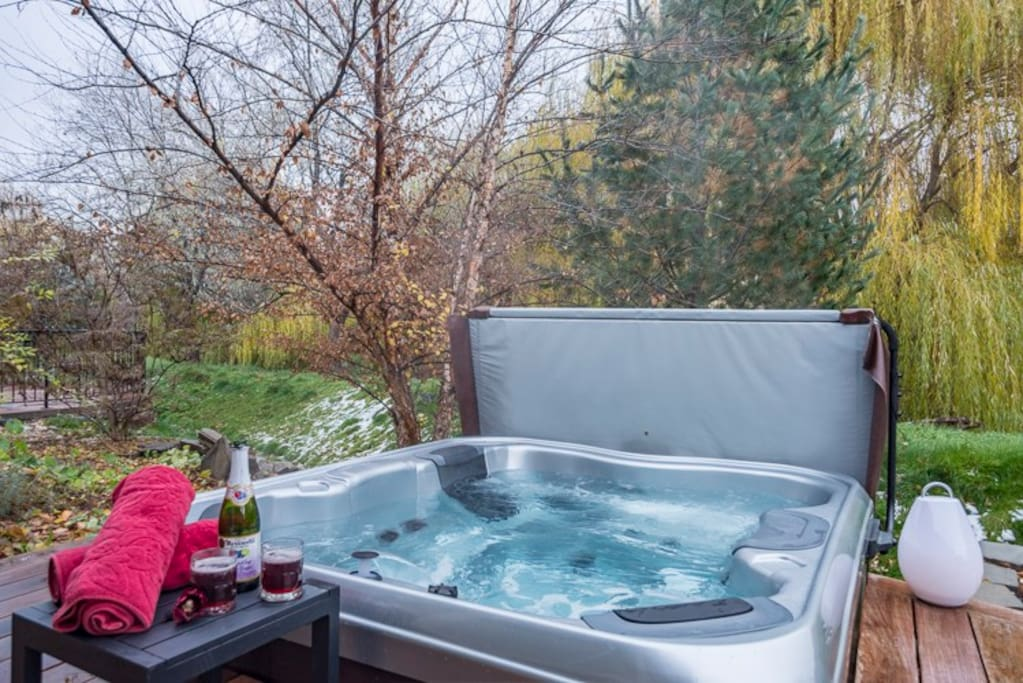 Hot tub with easily lifted cover.
