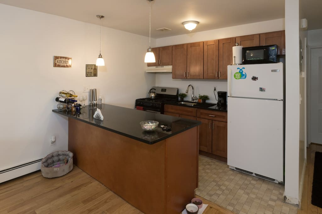 Kitchen has a microwave, stove and oven, pots and pans, and granite countertops.   Specialty and budget grocery stores are close by if you prefer to save money and cook.