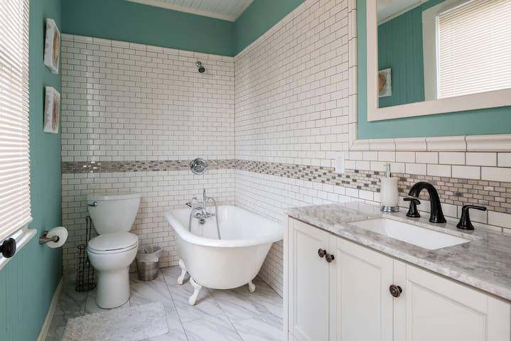 Bathroom 2: Take a relaxing soak in the claw foot tub.