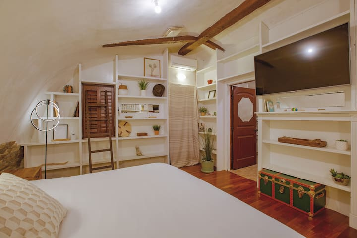 """A posh, cozy king-sized bed and 55"""" flat-screen tv"""