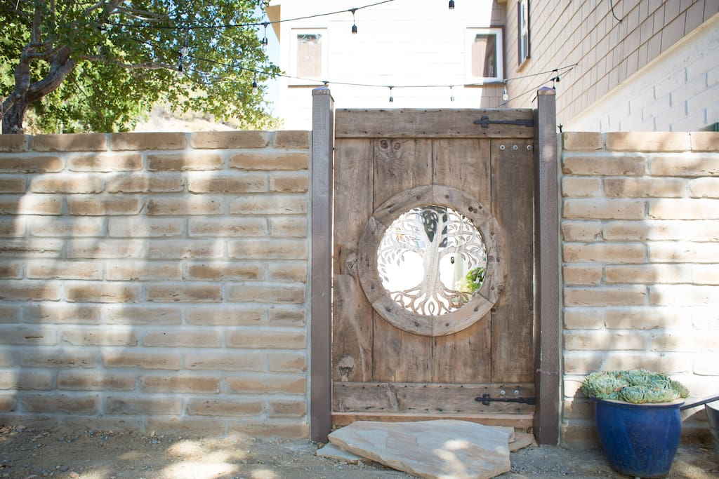Walk through this garden gate into a private adobe courtyard