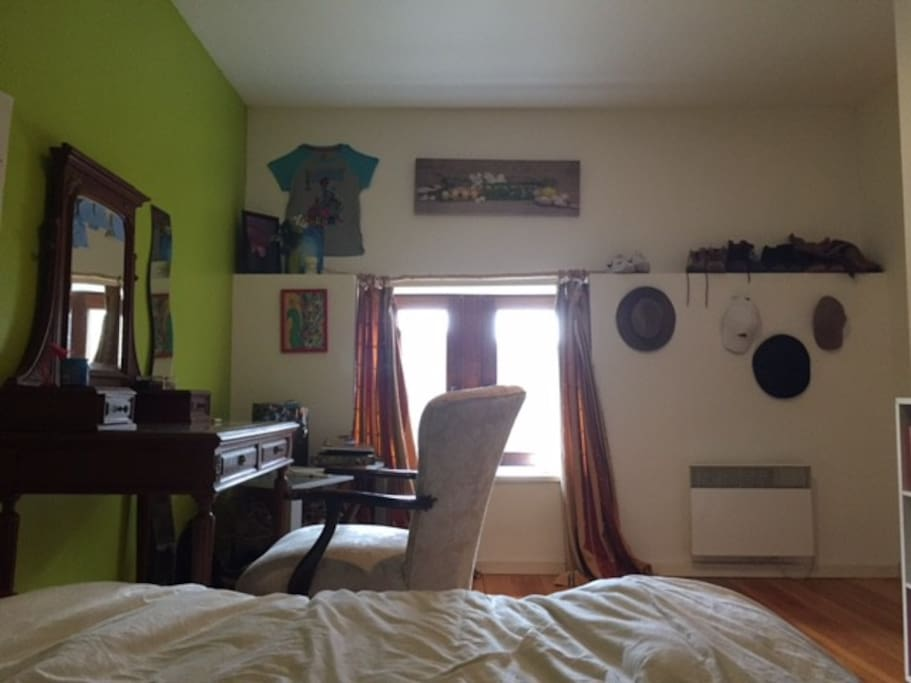 Cozy double bed with window looking out over prairies and river