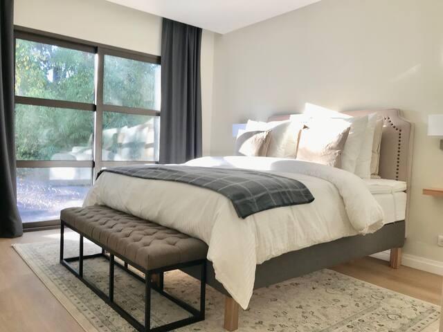 Bedroom with big TV & air conditioner