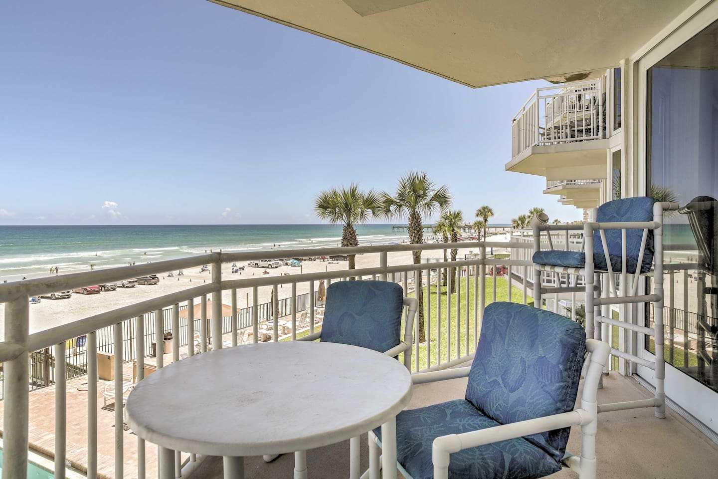 Enjoy gorgeous sunsets from the balcony during your stay in this condo.