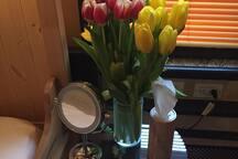 We always have fresh flowers in a vase.
