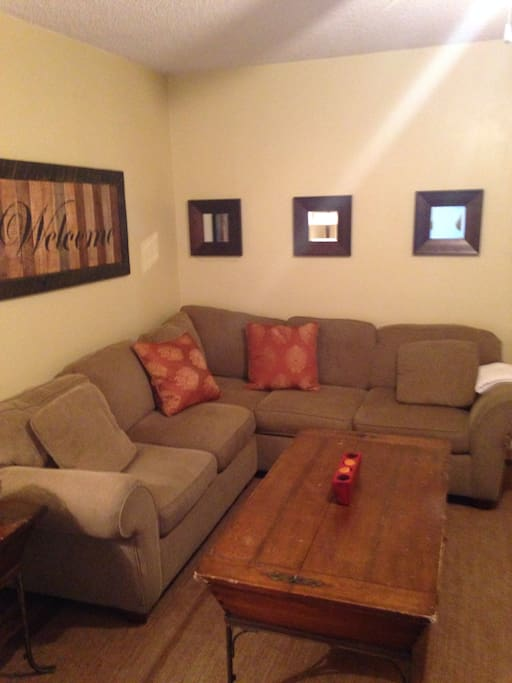 Large, comfy sectional in living room.