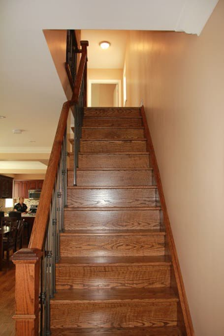 The staircase that leads to the second floor where the guest room is
