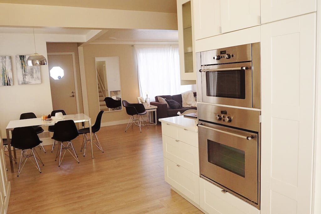 Open concept floor with kitchen area ( stove and microwave on right), and dining area