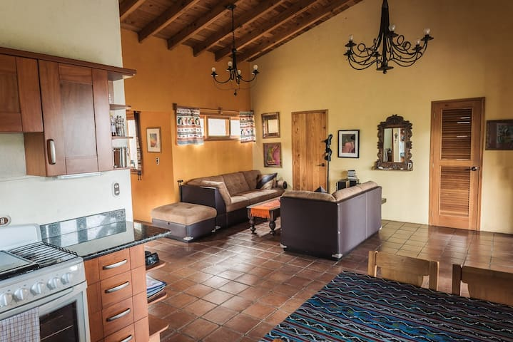 Living room, kitchen and table for 6 persons both inside and outside.