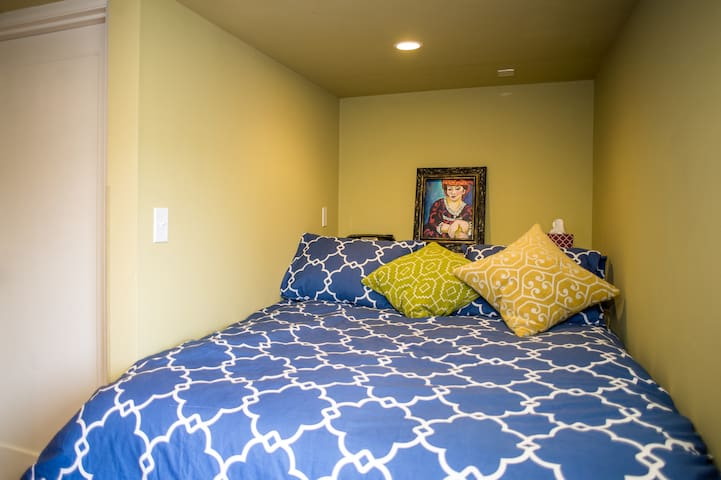Double bed in nook is cozy for two people.
